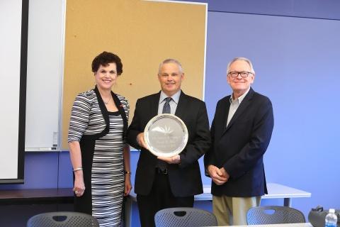 Linda Hagedorn, new IAE member Dan Clay, and Don Yarbrough