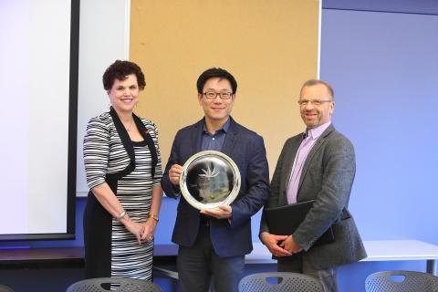 Linda hagedorn, new IAE member Won-Chan Lee, and David Bills.