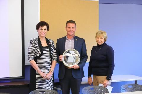 Linda Hagedorn, new IAE member Robert Reason, and Marlene Strathe